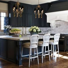 Aidan Gray Home - kitchens - dark blue cabinets, dark blue kitchen cabinets, white marble countertops, island with legs, island with turned ...