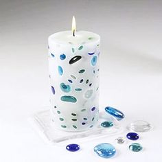 White candle studded with blue stones