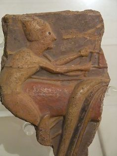 Fragment of an Etruscan terracotta bas relief depicting a charioteer C.750BCE
