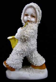 ca. 1930 Bisque Snowbaby with a Saxophone.