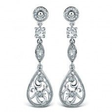 Bella Diamond & CZ Dropper Earrings   These 'Bella' vintage inspired dropper earrings are set with 4 sparkling diamonds and high quality cubic zirconia stones. These earrings are what making a statement is all about. Inspired by some of the great Art Nouveau jewellery of the1900's but with a modern twist and when worn with it's matching necklet be prepared to be stopped and admired! Lavishly coated in rhodium and beautifully boxed. Total drop 40mm £45