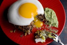 Cilantro and hot sauce flavored black bean cakes topped with fried eggs and tangy avocado sour cream add Mexican flavor to breakfast.