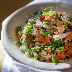 Couscous Salad with Turkey and Arugula | Sweet raisins, crunchy nuts, spicy arugula--this couscous salad boasts an interesting array of flavors and textures. We include strips of roasted or smoked turkey to make it a meal, but you can leave them out for a meatless salad.