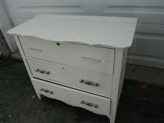 As found small 3 drawer dresser with cracked top kitchen hardware, chips and dents and painted white