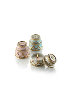 You will really want to devour these little 'cakes' in fine pastel coloured porcelain, encasing Chantilly cream scented candles. Skilfully created pouring pure wax into porcelain receptacles, these small wedding cakes seem to come straight from 18th century French palaces. Their sophisticated finish in 24 carat gold is the final touch of class.Available in three beautiful variations : white & gold, pink & gold, blue & gold.