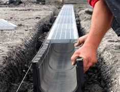 Pin by Tete Sánchez on Outdoor dog Gutter Drainage, Backyard Drainage, Landscape Drainage, Backyard Landscaping, Driveway Drain, Dog Kennel Designs, Trench Drain, Paver Designs, Drainage Solutions