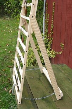 Display ladder. Could use old crib side & add legs