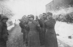 German prisoners surrender. Some of the German soldiers taken prisoner in this photograph turned out to be women.