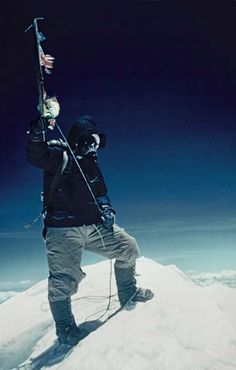 It is 11.30 a.m. on May 19 1953. Tenzing stands on the summit of Everest and waves his ice-axe, on which are hung the flags Britain, Nepal, the United Nations and India. On reaching this sacred spot, Tenzing placed a packet of biscuits, some chocolate and a handful of sweets into a hole in the snow as a gift to the gods who live on the summit.