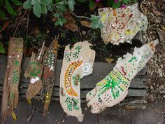 Children's paintings on bark inspired by Aboriginal dot paintings