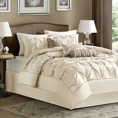 "Ivory comforter set with tufted detailing.  Product: Queen: 1 Comforter, 2 standard shams, 3 decorative pillows and 1 bedskirtKing: 1 Comforter, 2 king shams, 3 decorative pillows and 1 bedskirtCalifornia King: 1 Comforter, 2 king shams, 3 decorative pillows and 1 bedskirtConstruction Material: PolyesterColor: IvoryFeatures:  15"" Bedskirt dropAccent pillows include inserts    Dimensions: Lumbar Decorative Pillow: 12"" x 20""Cylinder Decorative Pillow: 6"" x 18""Square Decorative Pillow: 18"" x 18""S…"