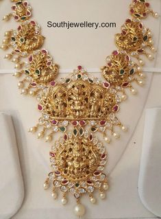 22 carat gold antique peacock nakshi haram with Goddess Lakshmi pendant adorned with uncut diamonds, rubies, emeralds and south sea pearls.