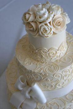 Buttercream wedding cake with sugar bow by The White Flower Cake Shoppe