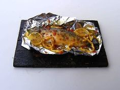 Sea bass in foil - Miniature in 1:12 by Erzsébet Bodzás, IGMA Artisan
