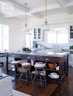 "A copy-cat kitchen of the one in the movie ""Something's Gotta Give"". A comfy, eclectic vibe by mixing elements like a farmhouse-style sink, vintage-looking faucets and industrial-inspired stools topped with a contemporary polka-dot fabric."