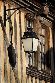 Street Light On A Medieval House - France