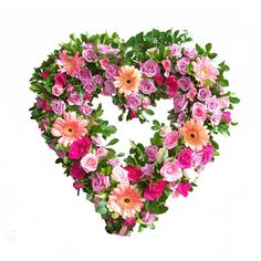A heart shaped wreath dedicated to her loving and compassionate nature- a special arrangement of pink, fuschia and white roses, gerberras and daisies. Roses are approximately 10-12 dozen. Approximate wreath size 14-inch (medium-sized) or 18-inch (large) outside diameter. A TABLE TOP STAND is included. Ribbon or card message is also included.