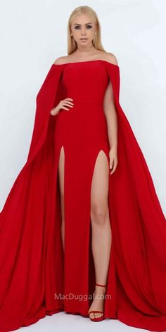 Be the queen of the night in the regal and elegant Double Slit Floor Length Cape Dress by Mac Duggal. This stunning ensemble features an off the shoulder neckline, jersey knit fabric and double thigh slits. The straight silhouette also includes a dramatic floor length cape with a sweep train that will not let you go unnoticed. #edressme