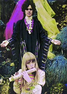 ~Donovan and Jenny Boyd 1967. Circa Fall 1967 - Jenny Boyd (the muse for Jennifer Juniper), playing flute in Donovans Pre-Raphaelite style infrared photo shoot for his album, Wear Your Love Like Heaven, at Bodiam Castle, East Sussex, by Karl Ferris who was his and Jimi Hendrix's personal photographer ~*