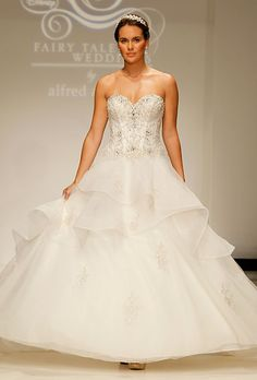 """Brides.com: . Style 217, """"Belle"""" strapless organza ball gown wedding dress with a beaded sweetheart bodice and tiered skirt, Disney Fairy Tale Weddings by Alfred Angelo"""