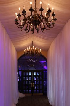 Dramatic Wedding Reception Entrance to the Ballroom Designed by Events by Reese created with Pipe & Draping at Sonterra Country Club.