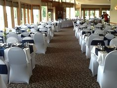 White chair covers with navy blue ties