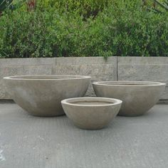 This set of 3 modern garden pots are crafted using the new environmentally friendly ' fibre clay'. Description from savvysurf.co.uk. I searched for this on bing.com/images