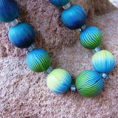 Polymer clay beads by Saffron Addict, via Flickr