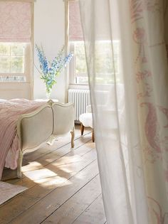 Pretty. Soft pink and antiques but the blue flowers make the room work and come alive.