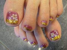 Pretty pedicure: Mauve polish with gold Sparkle tips, white flower design w/gold center and a couple rhinestones.