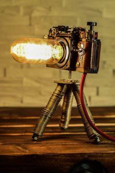 KAMERALAMPE - Steampunk Diese und weitere Kameralampen habe ich in liebevoller H. CAMERA LAMP - Steampunk These and other camera lamps I have lovingly made by hand. The most defective cameras were b Lampe Industrial, Industrial Lighting, Cool Lighting, Diy Home Decor Rustic, Upcycled Home Decor, Diy Furniture Nightstand, Lampe Steampunk, Wooden Cupboard, Deco Luminaire