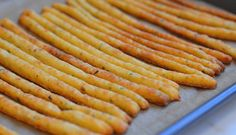 These crisp and flaky cheese straws specked with fresh herbs and crushed red chili flakes make a wonderful hors d'oeuvre to go along with wine and cocktails, and they're also delicious with a bowl of tomato or vegetable soup. Though they look like bread sticks, they're actually more akin to savory pie crust or pastry. I find them wildly addictive, and just plain …