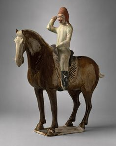 Horse and rider, Tang dynasty (618–906), early 8th century  China - Earthenware with three-color (sancai) glaze and pigment