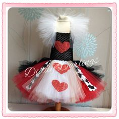 Queen Of Hearts Tutu Dress. Alice In Wonderland Tutu Dress. Princess Tutu Dress. Girls Queen Tutu Dress. Beautiful & lovingly handmade. Price varies on size, starting from £25. Please message us for more info. Find us on Facebook www.facebook.com/DiddyDarlings1 or our website www.diddydarlings.co.uk