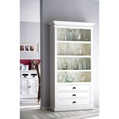 This elegant bookcase is made with quality mahogany and has three drawers for additional storage. Its four shelves are ideal for display and easy access of whatever you want to place on them.