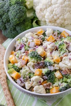 Flavorful and simple cauliflower salad with a creamy crunch! Filled with veggies, onions, bacon, sunflower seeds and cheese, this salad is sure to be a hit at any BBQ or get together. Broccoli Cauliflower Salad with Homemade Dressing Broccoli Cauliflower Bacon Salad, Fresh Broccoli, Cauliflower Recipes, Broccoli Salads, Chicken Caesar Salad, Grilled Chicken Salad, Great Salad Recipes, Healthy Recipes, Healthy Options