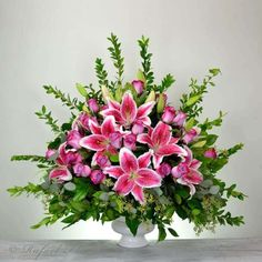 A condolence flower arrangement of lavender roses and stargazer lilies is a beautiful way to send your message of support to the family of the bereaved Altar Flowers, Church Flowers, Funeral Flowers, Flower Vases, Wedding Flowers, Flowers Garden, Diy Flowers, Wedding Bouquet, Creative Flower Arrangements