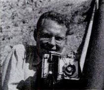 George Strock (1911-1977) American photojournalist during World War II, when he took a picture of the bodies of three American soldiers killed during a Battle of Buna-Gona, New Guinea. It became the first photograph to be published during World War II, to depict dead American troops on the battlefield. Life correspondent Cal Whipple went all the way to the White House to get permission to print the image.