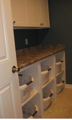This would be great in a laundry room. could do this on the shelves that we have in the big closet!