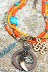 Necklace  Old Orange Glass Trade Bead, African Brass, Copper, Terra Cotta, Turquoise, Bone, Silver Shield Fetish, Horseshoe, Celtic Knot, Tiger Claw and Iron Circle Multi-Media Pendant Necklace