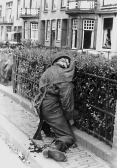 During the fight for Onderlangs, this British Para's smock caught the fence when he was hit and he died in this position. Operation Market Garden, Arnhem, September 19, 1944. Brave man......
