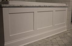 White paneled tub apron/ skirt