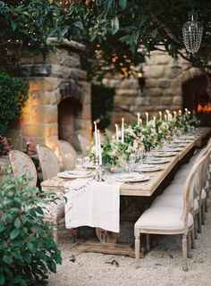 beautiful long table for a family and friend feast. Wild leaves and flowers and simple natural colours.