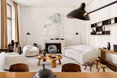 scandinaviancollectors:  The apartment of Emmanuel de Bayser in Berlin: Jean Royère L´Ours Polaire sofa group (1949) and Œuf-chair (1953), Paul Frankl coffee table (ca.1940s), Nuage-book shelf and stools by Charlotte Perriand and all lighting by Serge Mouille (ca.1950s). Photography by Manolo Yllera. / Architectural Digest Espana