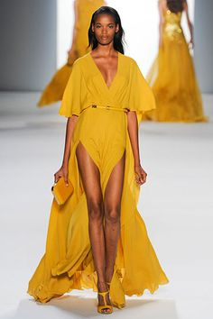 Elie Saab Spring 2012 collection. Spanish Gold yellow looks hot and sexy in this deep v-neck, double slit dress. Hot!