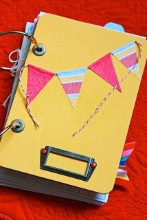 banner book -  make with bind it all!! like the eyelets and metal label with brads at bottom {also see a tab peeking out at top!} very cute! needs a title though.
