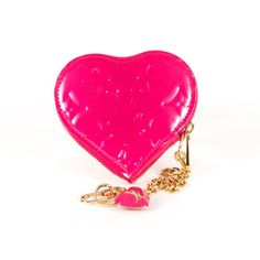 Louis Vuitton Porte Monnaie Coin Case-This authentic Louis Vuitton Coin Case is so chic! Heart shaped and compact in size but not in style, featuring LV signature vernis monogram canvas in fuchsia, and a top zipper closure with golden-tone Louis Vuitton zipper pull. The gusseted heart coin purse attaches to the D-ring found on most bags of the house.Perfect for everyday use! SEE DETAILS: http://www.designerhandbagspurses.net/designer-handbags-are-worth-the-splurge/