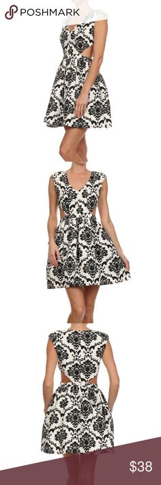 Mono Pattern Cutout Skater Dress Feminine meets cyber chic in this mini padded shoulder and side cutout skater dress.  Gorgeous mono pattern with back zipper closure.  Color - Ivory / Black.  Size-S,M,L Classic Paper Doll Dresses Mini