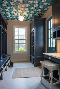gorgeous blue mudroom with wallpapered ceiling