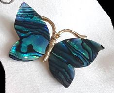 This vivid butterflys wings are made from abalone shell mounted on a gold toned body. Abalone shell is said to bestow creativity and tranquility onto the wearer and release the imagination and of course the butterfly symbolises rebirth. Abalone Shell, Handmade Items, Handmade Gifts, Shells, Gemstone Rings, My Etsy Shop, Butterfly, Brooch, Trending Outfits